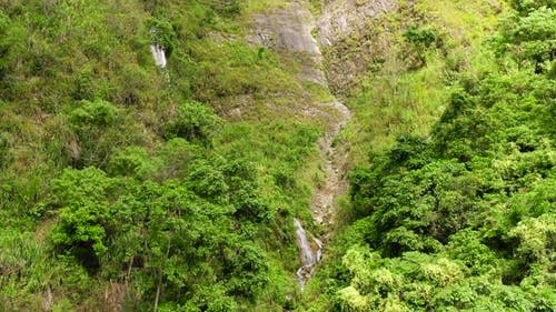 Cliff with a Waterfall in the Jungle. Cascade Waterfall on Luzon Island, Philippines