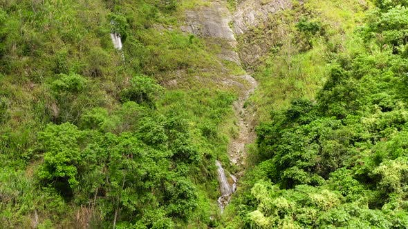 Thumbnail for Cliff with a Waterfall in the Jungle. Cascade Waterfall on Luzon Island, Philippines