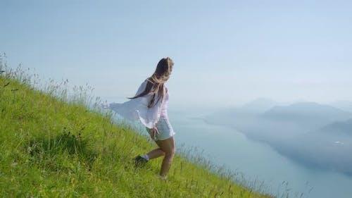 Girl Walks on the Grass with a Beautiful Panorama of Lake Garda