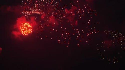 Festive Fireworks in Night Sky of Big City