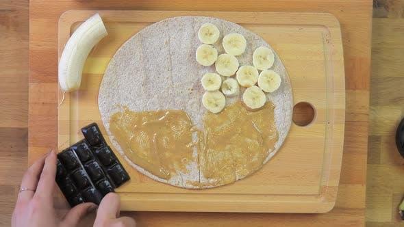 Preparing a Peanut Butter, Chocolate and Banana Toast Sandwich