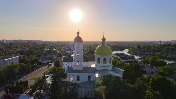 Thumbnail for Small Church at the Bright Cloudy Sunset Filmed By Drone in Small European City, Kyiv Region