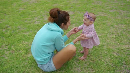 Baby Takes First Steps in Grass