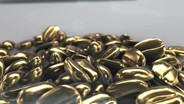 Golden coffee beans lie on a gray background. 3D animation of heaps of golden coffee beans