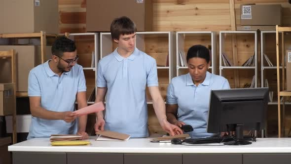 Cover Image for Multiethnic Post Office Clerks Registering Mail Together