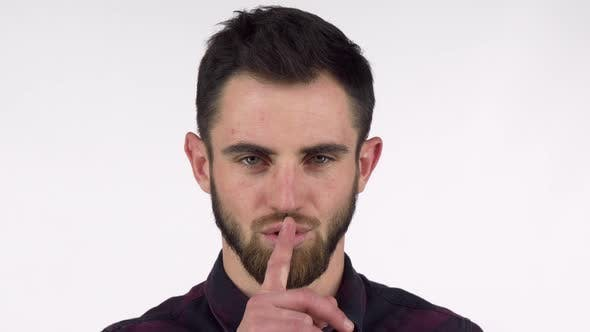 Thumbnail for Attractive Bearded Man Shushing To the Camera with Finger To His Lips