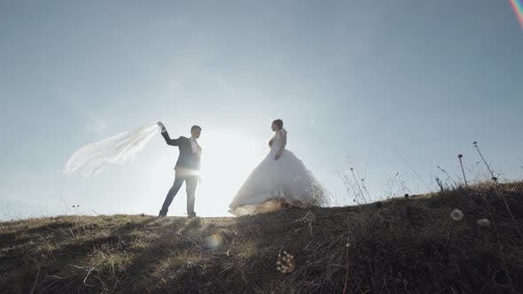 Thumbnail for Newlyweds. Caucasian Groom with Bride on Mountain Slope. Wedding Couple. Happy