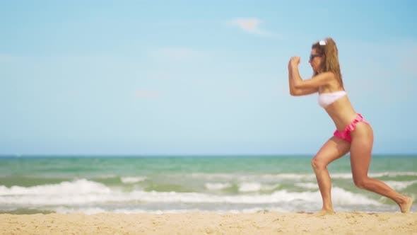 Thumbnail for A Girl in a Bathing Suit Plays Sports Against the Backdrop of the Sea
