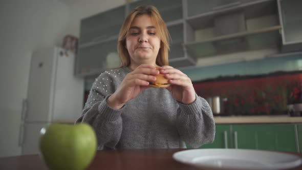 Thumbnail for Chubby Girl Thinks That She Should Eat a Tasty Hamburger or a Juicy Green Apple