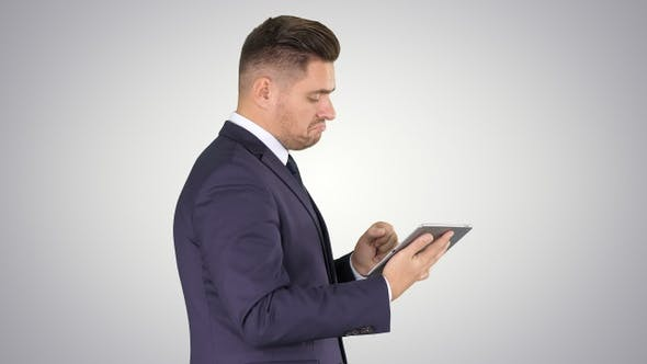 Thumbnail for Smart Senior Businessman Using a Technology Tablet on Gradient