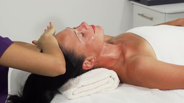 Thumbnail for Happy Mature Woman Receiving Head and Neck Massage