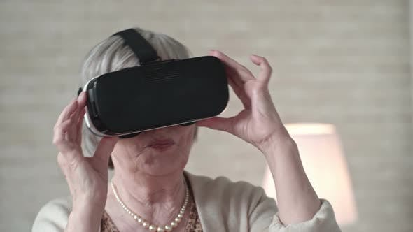 Thumbnail for Old Woman in VR Headset Dancing with Excitement