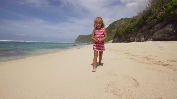 Thumbnail for Child Runs Along the Beach.