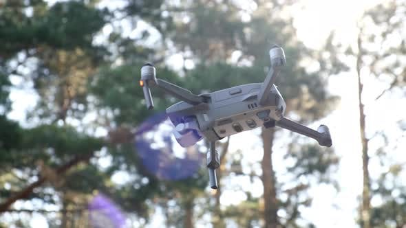Thumbnail for Copter Hover in Air, Low Angle Shot Against the Sky. Flying Drone Against the Sun Rays. Remote