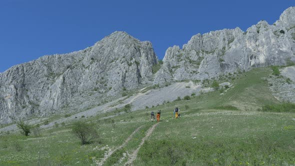 Thumbnail for People and dog hiking towards Piatra Secuiului