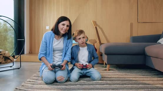 Thumbnail for Mother Playing Video Game with Her Handsome Small Son in the Living-Room