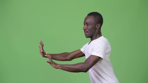 Thumbnail for Young African Man Resisting Something As Concept