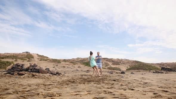 Thumbnail for Couple on sandy beach