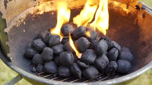 Closeup Of Glowing Coal In Metal Grill On Summer Day