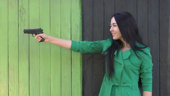 Thumbnail for Pistol in hands of girl