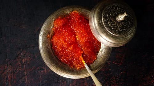 A Plate of Red Caviar Slowly Rotates on the Table