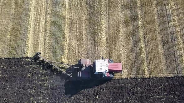 Thumbnail for Aerial View of a Tractor Plows a Field. Harvest Concept