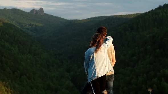 Thumbnail for A Young Couple of Lovers on Top of a Mountain