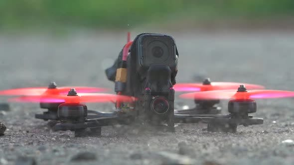 Thumbnail for Slow Motion of FPV Freestyle Drone Takes Off and Blows Dust and Debris Around Itself