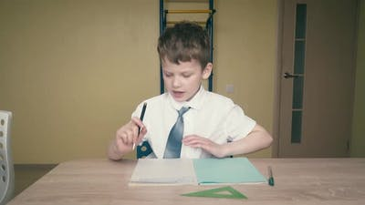 Schoolboy Does Homework the Wrench in His Hands is a Pen