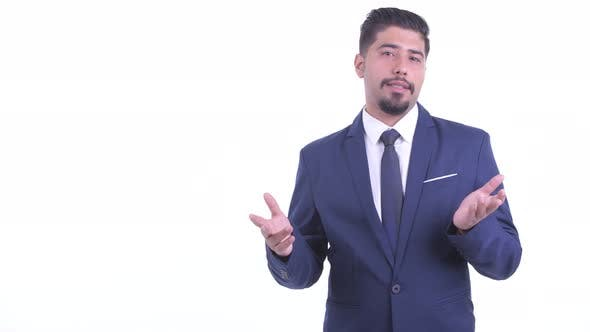 Thumbnail for Happy Bearded Persian Businessman Snapping Fingers and Talking