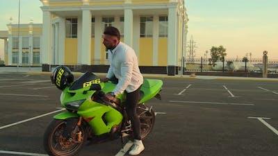 Stylish Businessman with Moto Scooter on Urban Street