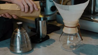 Barista preparing Filter coffee with fresh coffee beans. Trendy drink