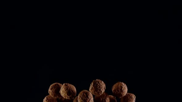 Thumbnail for Closeup Dark Chocolate Truffles Colliding with Luster Cocoa Powder in Air