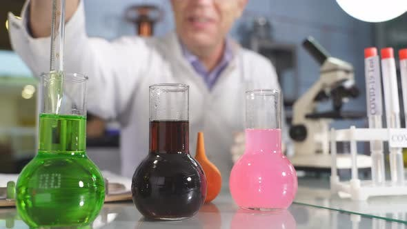 Chemist Conducting Laboratory Research with Microscope Test Tubes Medicines