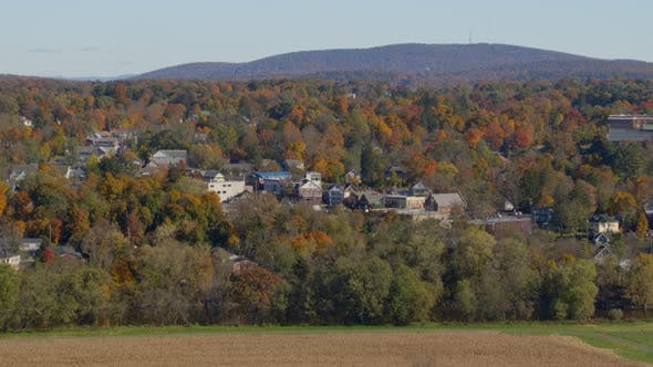 Aerial of autumn trees and houses in Hudson valley
