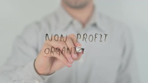 Non Profit Organization Writing on Screen with Hand