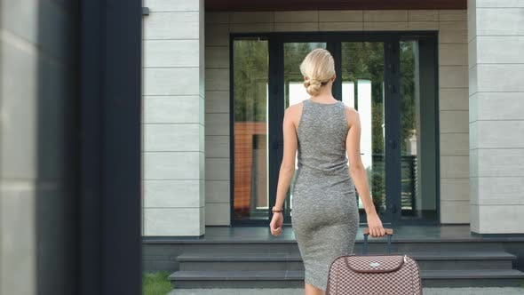 Sexual Woman Entering Luxury Apartments. Business Traveller Coming Home
