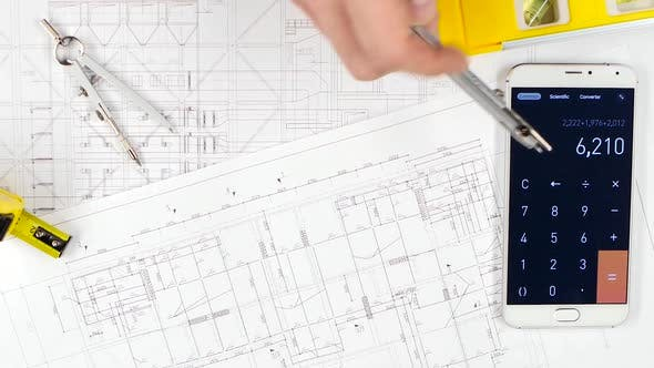 Architects Make Calculations with the Help of a Calculator and Correct Mistakes. Close Up