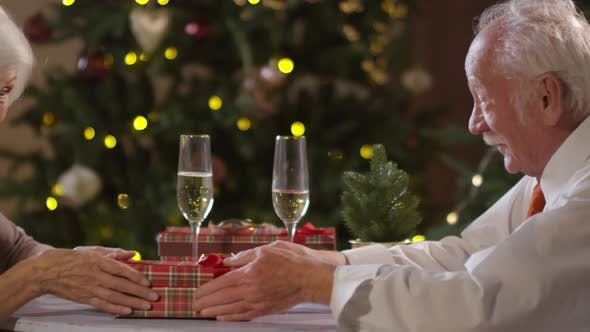 Cover Image for Elderly Woman Receiving Christmas Gift from Husband