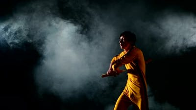 Karate Man. Exercise with Nunchaku, From the Young Karate