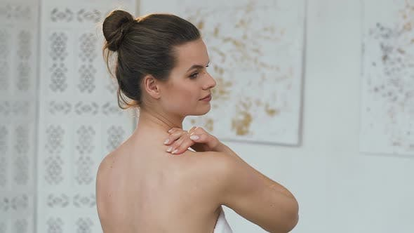 Thumbnail for Beautiful Woman Massaging Her Neck With Cream