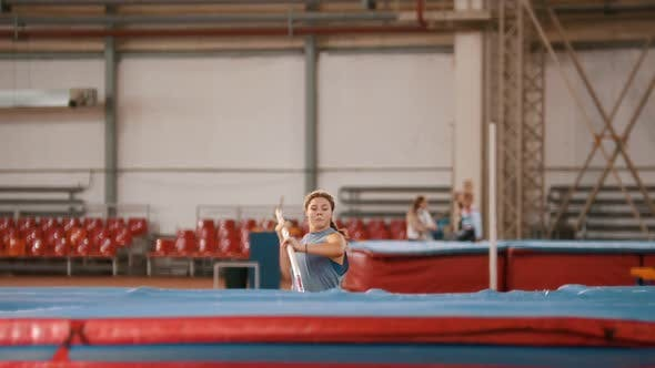 Thumbnail for Pole Vaulting - Young Athlete in Gray t Shirt Is Running and Jumping Over the Bar
