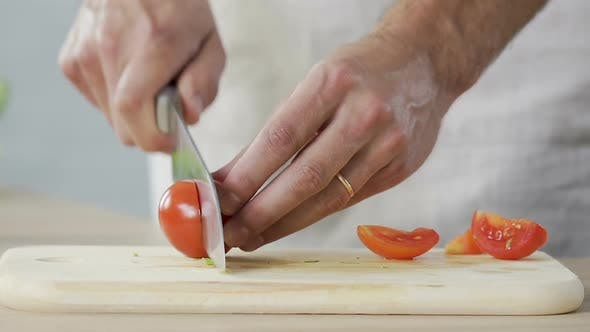 Thumbnail for Chef Cutting Tomatoes In Kitchen And Adding It To Dish Cooking