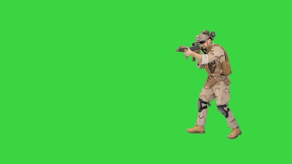 Armed Marine Soldier with Assault Rifle Walking By Aiming on a Green Screen, Chroma Key