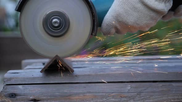 Thumbnail for Worker in Gloves Use Angle Grinder