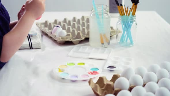 Thumbnail for Little girl painting craft Easter eggs with acrylic paint