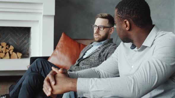 Diverse Homosexual Couple Having Consultation with Female Psychologist