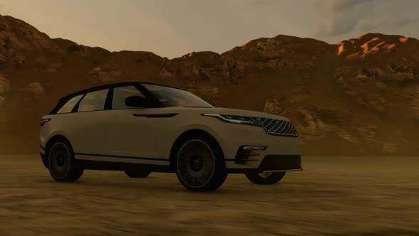 SUV Drives Through Mountain Terrain