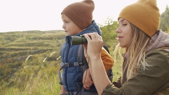 Woman and Boy Enjoying Nature