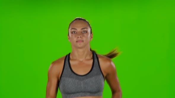 Thumbnail for Läufer weiblich. Vorderansicht. Grüner Bildschirm